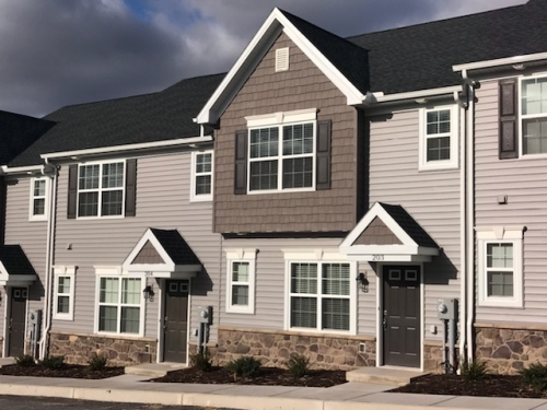 townhomes with tan siding