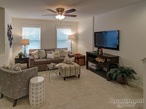 living room area with ceiling fan
