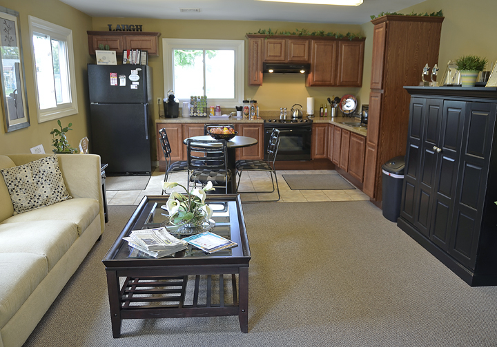 living room and kitchen photo from back of living room
