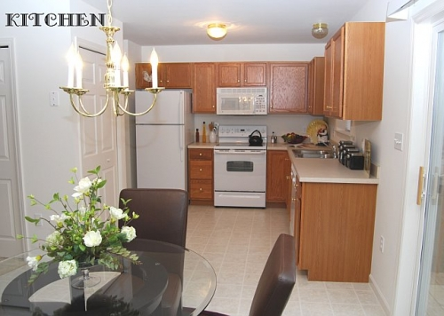 kitchen with white appliances and wood cabinets